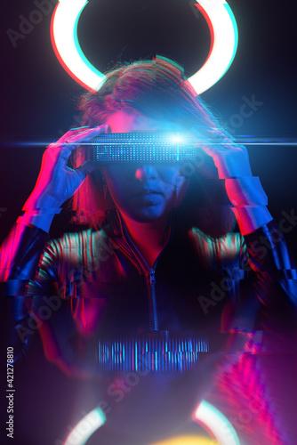 Fototapeta Cyberpunk style portrait of beautiful young woman in futuristic costume. Image with glitch effect. obraz