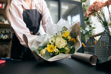 Portrait Of Successful Modern Florist Wearing Apron, Creating Beautiful Bouquet Of Colorful Different Flowers In Modern Interior Floral Shop. Close Up.