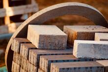 Close-up Of Rusty Metallic Blocks During Sunny Day