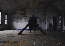 Rear View Of Person Standing In Abandoned Building