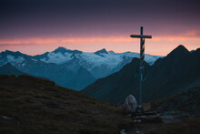 Cross On Mountains Against Sky During Sunset