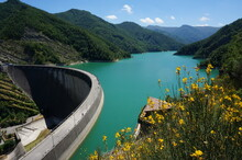 Beautiful Dam In Ridracoli,  Italy During Summer With Green Water In Lake And Blue Sky Background