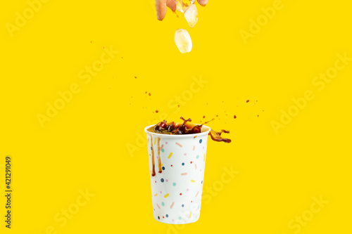 Carta da parati coffee glass with splash and ice cubes, morning coffee