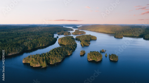 Aerial view of small islands on a blue lake at sunset Fototapet