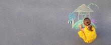 The Child Draws A House On The Asphalt. Selective Focus.