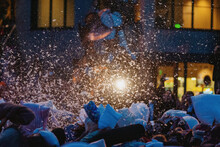 Group Of People Pillow Fighting Outdoors