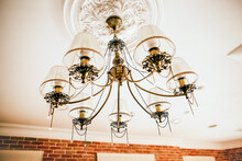 The Chandelier Hangs On The Ceiling. Beautiful Vintage Lamp In The Interior Of The Apartment. Apartment Design. Lighting In The House. Boho Style. Elegant Fixture.