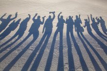 Silhouettes Shadows On Snow With A Group Of Photographers In Nature.