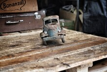 Rusty Old Toy Car On Wooden Table