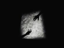 Shadow Of Hand On The Dark