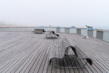 The Pier Of Hastings On A Misty Summer Day With Benches And Telescopes, No People, Sea
