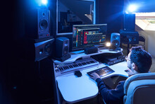 Professional Male Sound Engineer Mixing Audio In Recording Studio. Music Production Technology, Working On Mixer