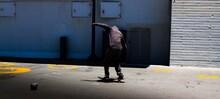 Full Length Of Man Skating On A Board