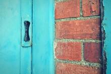 Close-up Of Blue Door With Brickwork