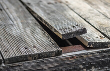 Exterior Pine Wooden Floor Bending Due To Climate Change, Front Focus Blurred Background
