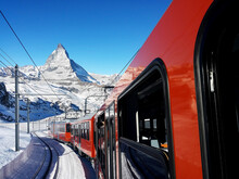 Train On Snow Covered Mountain Against Blue Sky, Mt Matherhorn Switzerland