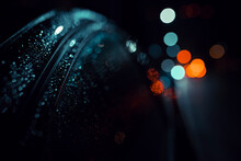 Defocused Image Of Wet Car And Lights
