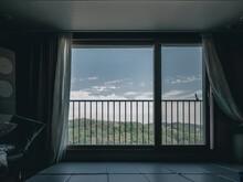 Scenic View Of Mountain Seen Through Window