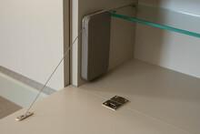 Hinged Cabinet Door In Open Position. Bar Door Hinge And Bar Door Stopper. Modern Furniture Technologies.