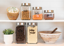 Dry Food Ingredients In Glass Jars On A Kitchen Shelf