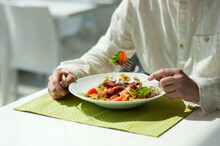 Midsection Of Man Having Food On Table