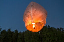 Low Angle View Of Paper Lantern Flying Against Clear Sky