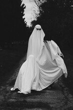 People Wearing Ghost Costume Standing Outdoors