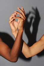 Two Different Skin Tone Hands Holding Together