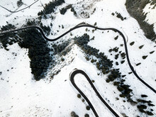 Long Winding Rural Road With Snow