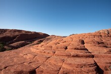 Landscape Of Red Step Rock Formations In Snow Canyon State Park In Utah