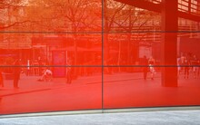 Reflection In Modern Red Glass Facade In City