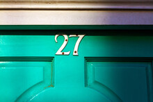 House Number 27 On A Wooden Front Door