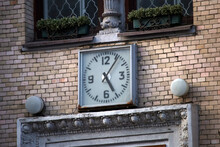 Old Vintage Clock On The Brick Wall