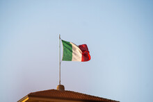 Low Angle View Of Italy Flag Against Blue Sky