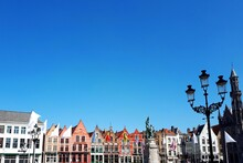 Low Angle View Of Buildings Against Clear Blue Sky In Bruges