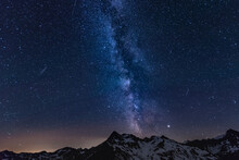Scenic View Of Mountains Against Star Field At Night