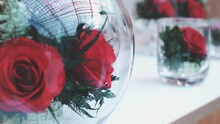 Close-up Of Red Rose In Glass Vase On Table