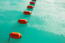 High Angle View Of Ropes Buoys In Lake