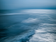 Aerial View Of Seascape Against Sky At Dusk