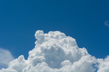 Low Angle View Of Cumulonimbus Clouds In Blue Sky.