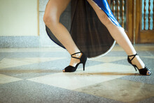 Low Section Of Woman Dancing On Tiled Floor