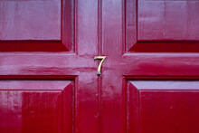 House Number 7 On A Red Wooden Front Door In London
