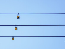 Low Angle View Of Alphabets Hanging On Cables Against Clear Sky