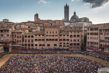 Group Of People In Front Of Building. Piazza Del Campo, Siena.