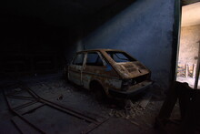 Abandoned Car In Garage