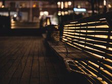 Empty Bench On Footpath In City At Night