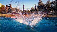 Close-up Of Splashing Water At Pool