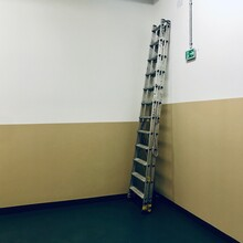 Low Angle View Of Ladder On Wall At Home