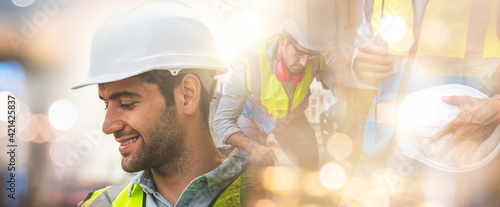 Fototapeta Double exposure of engineer cuacasian man is on duty in work site with abstract bokeh backgrounds. obraz