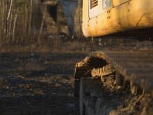 Old Rusty Excavator On Land